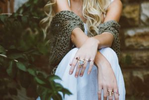 modern bohemian lifestyle woman with rings and shawl