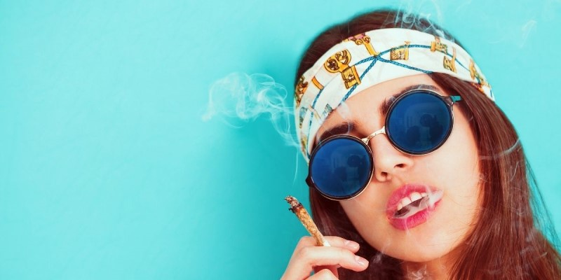 Modern hippie glasses and bandana smoking